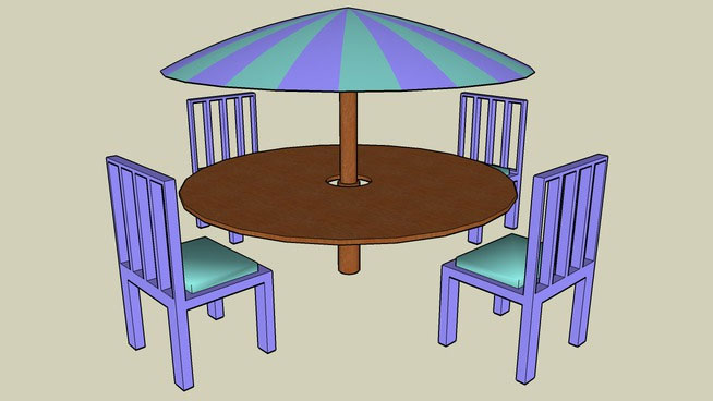 Table with sunbrella and chairs